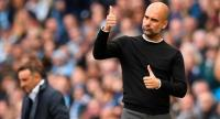 Manchester City's Spanish manager Pep Guardiola gestures on the touchline during the English Premier League football match between Manchester City and Swansea at the Etihad Stadium in Manchester, north west England, on April 22, 2018. / AFP PHOTO