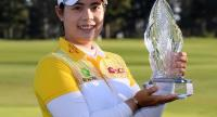 Moriya Jutanugarn of Thailand poses with the trophy after her win during round four of the Hugel-JTBC Championship at the Wilshire Country Club on April 22, 2018 in Los Angeles, California. Harry How/Getty Images/AFP
