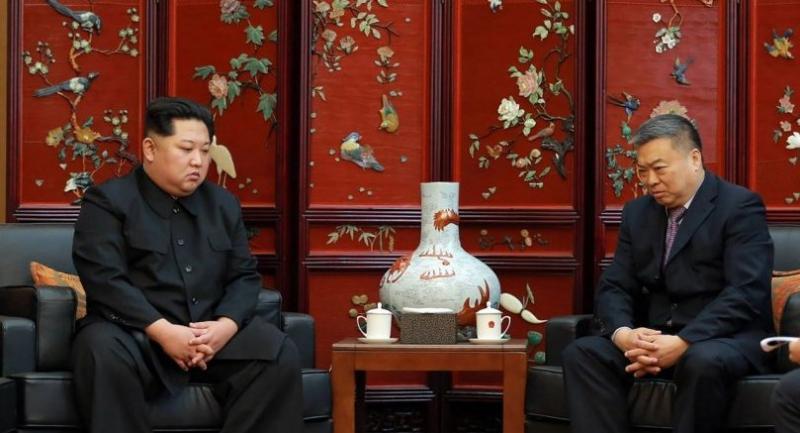 North Korean leader Kim Jong-Un (L) meets Chinese Ambassador to North Korea Li Jinjun (R) at the Chinese embassy in Pyongyang on Monday./AFP