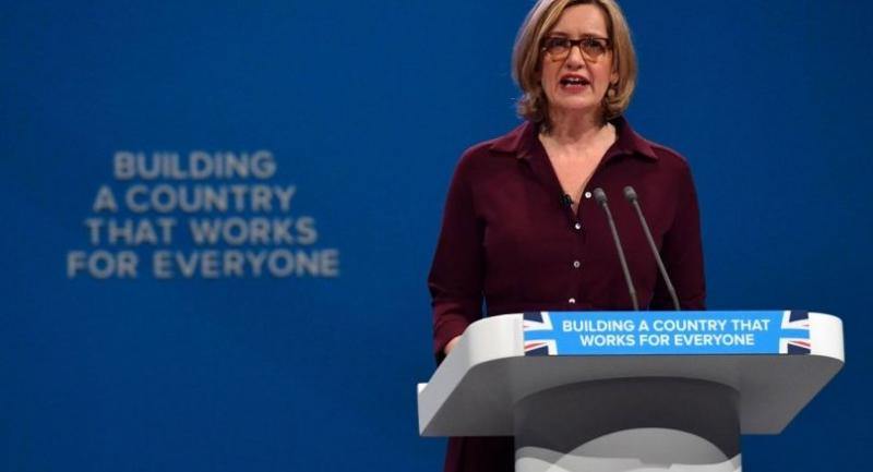 In this file photo taken on October 3, 2017 Britain's Home Secretary Amber Rudd delivers a speech on the third day of the Conservative Party annual conference at the Manchester Central Convention Centre in Manchester./AFP