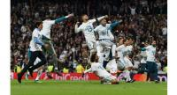 Real Madrid's players celebrate after the UEFA Champions League semi-final second-leg football match Real Madrid CF vs FC Bayern Munich in Madrid, Spain, on May 1, 2018.  Christof STACHE / AFP