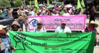 Members of the People's Movement for a Just Society (P-Move) march from the United Nations headquarters in Bangkok to Government House yesterday to submit a petition to Prime Minister General Prayut Chan-o-cha.