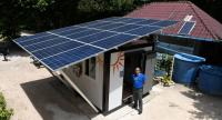 KMUTT research team Usa Boonbumroong and the pioneering renewable electricity generation station at Koh Hong Island
