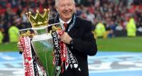In this file photo taken on May 12, 2013 Manchester United's Scottish manager Alex Ferguson holds the Premier League trophy at the end of the English Premier League football match between Manchester United and Swansea City.
