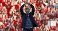 Arsenal's French manager Arsene Wenger gestures to supporters on the pitch after the English Premier League football match between Arsenal and Burnley at the Emirates Stadium in London on May 6, 2018