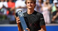 Germany's Alexander Zverev poses with the trophy after defeating his compatriot Philipp Kohlschreiber in their final match at the ATP Tennis Open in Munich, southern Germany, on May 6, 2018. / AFP PHOTO / Christof STACHE