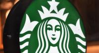 In this file photo taken on April 17, 2018 the sign for a Starbucks Coffee shop is seen in New York./AFP