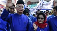 In this file photo taken on April 28, 2018, Malaysia's then-Prime Minister Najib Razak (L) and his wife Rosmah Mansor (R) wave as they arrive at the nomination centre to hand over election documents in Pekan./AFP