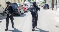 Mobile brigade police patrol around the Surabaya police headquarters following a suicide attack in Surabaya on May 14, 2018. /AFP