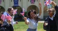 Students at Immaculate Heart High School and Middle school dance and sing with US and British flags during a program on May 15, 2018 in Los Angeles to honor alumna Meghan Markle, who is engaged to Marry Britain's Prince Harry./AFP