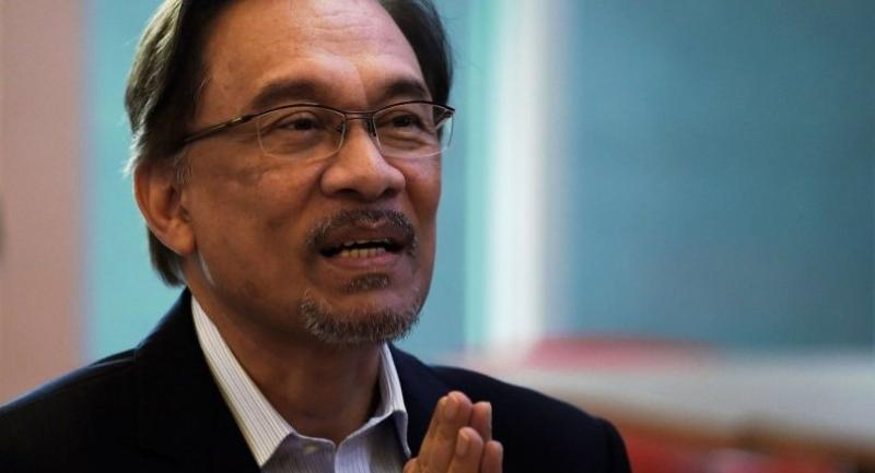 In this file photo taken on October 31, 2014 Malaysian opposition leader Anwar Ibrahim gestures during a tea-break at the Federal courthouse in Putrajaya, outside Kuala Lumpur./AFP