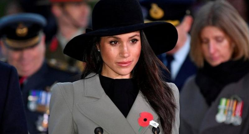 n this file photo taken on April 25, 2018 Meghan Markle, the US fiancee of Britain's Prince Harry, attends an Anzac Day dawn service at Hyde Park Corner in London on April 25, 2018. /AFP