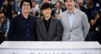 """Directors Chulayarnnon Siriphol, Wisit Sasanatieng and Aditya Assarat, from left,  pose during the photocall for """"10 Years in Thailand"""" at the 71st annual Cannes Film Festival./EPA-EFE photo"""