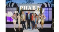 Phuket Hotels Association president Anthony Lark, third left, and Phuket Hotels Association Development Director Sumi Soorian, third right, welcome Phuket Vice Governor Sanit Sriwihok and his wife to PHAB 2 annual fundraising event.
