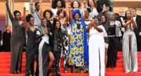 Burundian singer and member of the Feature Film Jury Khadja Nin, centre, poses with the 16 black women who fight for equality and inclusion of black women in the French film industry. AFP Photo