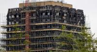 Construction work is seen continuing on the burned-out shell of Grenfell Tower in west London on May 11, 2018. // AFP PHOTO
