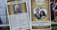 A picture shows Royal Family Top Trumps cards, a card game where you compare ratings and values to try to 'trump' and win your opponents card, showing Britain's Prince Charles, Prince of Wales (L) hanging on a barrier in Windsor on May 18, 2018./AFP
