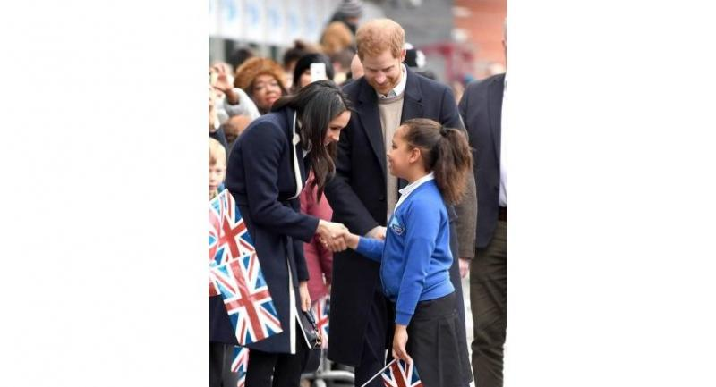 Meghan Markle and Prince Harry meet children during a visit to Birmingham on March 8. AFP
