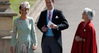 Pippa Middleton (L) and her husband James Matthews (2L) arrive for the wedding ceremony of Britain's Prince Harry, Duke of Sussex and US actress Meghan Markle at St George's Chapel, Windsor Castle, in Windsor, on May 19, 2018. / AFP PHOTO /