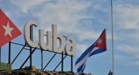 The Cuban national flag is raised at half-mast in tribute to the victims of a plane that crashed shortly after taking off from Jose Marti airport and killed 107 people, in Havana, on May 19.//AFP