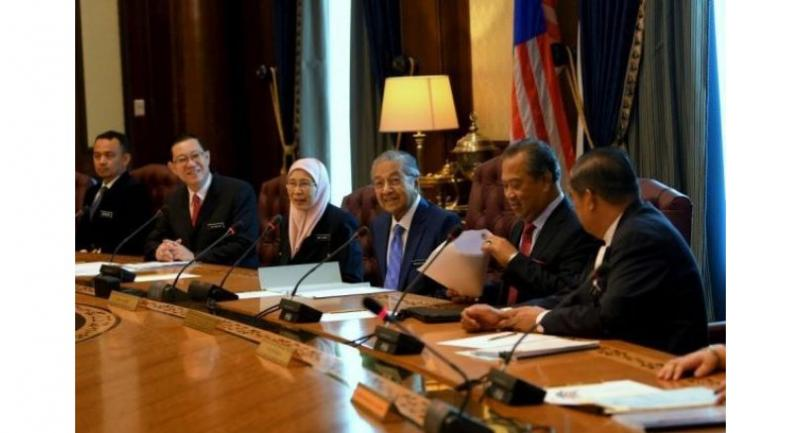 Dr Mahathir (third from right) charing his first Cabinet meeting at Perdana Putra on Wednesday.