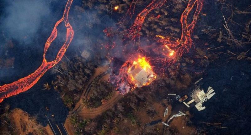 An aerial view of a home bursting into flames as it is consumed by lava in Pahoa, Hawaii, USA, 22 May 2018. // EPA-EFE PHOTO