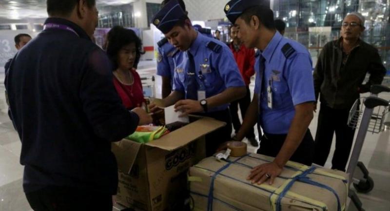 Airport staffers check luggage belonging to passengers at Terminal 3 of Soekarno-Hatta International Airport in Banten on Aug 9, 2016.