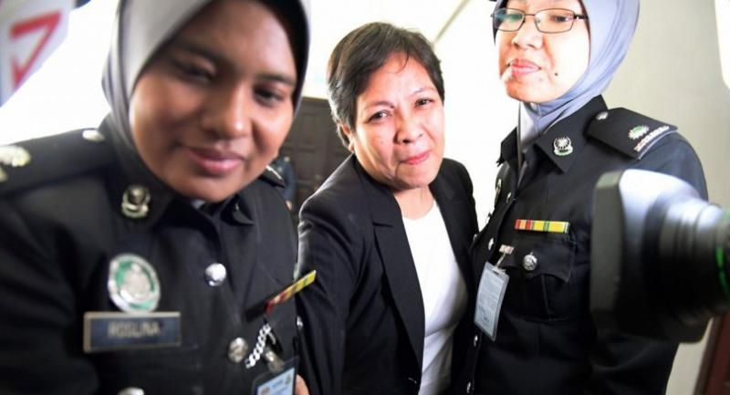 File: Maria Elvira Pinto Exposto (C) reacts after she was cleared of drug trafficking charges at Shah Alam High Court in Shah Alam, outside Kuala Lumpur, on December 27, 2017. // AFP PHOTO