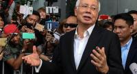 Malaysia's former prime minister Najib Razak speaks to the media after being questioned at the Malaysian Anti-Corruption Commission (MACC) office in Putrajaya on May 24, 2018./AFP