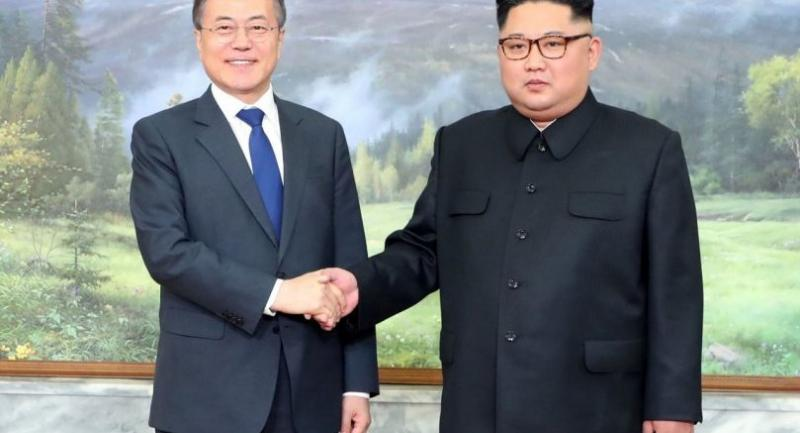 South Korea's President Moon Jae-in (L) shaking hands with North Korea's leader Kim Jong Un before their second summit at the north side of Panmunjom in the DMZ Saturday./AFP