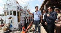 Prime Minister Prayut Chan-o-cha visits the Samut Sakhon Fishery Organisation in March to make an inspection of method of iris scanning to verity migrant workers' identity.