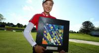 MinJee Lee of Australia poses with the championship trophy after winning the LPGA Volvik Championship on May 27, 2018 at Travis Pointe Country Club Ann Arbor, Michigan. Gregory Shamus/Getty Images/AFP