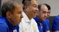 Thai football chief Somyot Poompanmoung, 2nd from left, during a meeting with players.