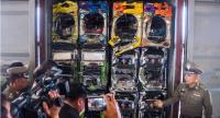Deputy National Police Commissioner Pol General Wirachai Songmetta displays discarded gaming machines found at a plant inside the Laem Chabang Industrial Estate in Chon Buri province.