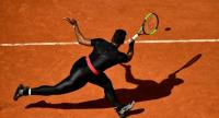 Serena Williams of the US plays a backhand return to Czech Republic's Kristyna Pliskova during their women's singles first round match on day three of The Roland Garros 2018 French Open tennis tournament in Paris on May 29, 2018. / AFP PHOTO / CHRIST