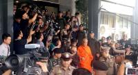 Phra Phromsitti, centre, the former abbot of |Sa Ket Temple, one of the major Buddhist temples in Thailand, is escorted from the Crime Supression Division to a court after his surrender yesterday. He was denied bail, leading to his defrocking.
