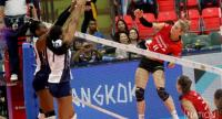 Louisa Lippmann of Germany jumps to attack Dominican players.