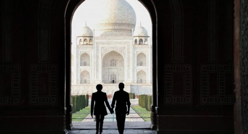 In this file photo taken on March 11, 2018 French President Emmanuel Macron (R) and his wife Brigitte Macron at the Taj Mahal in the Indian city of Agra./AFP