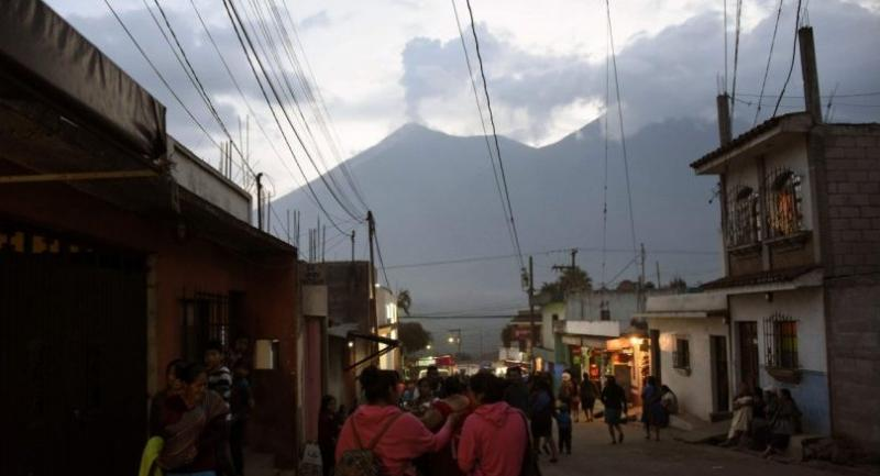 Ash billows from the Fuego volcano, as seen from the streets of Alotenango municipality, Sacatepequez, about 65 km southwest of Guatemala City, on June 4, 2018./AFP