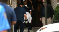 The body of fashion designer Kate Spade, who was found dead in her apartment of an apparent suicide, is brought out of her apartment building on June 5, 2018 in New York City./AFP