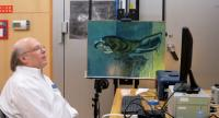 Washington-based National Gallery of Art researcher John Delaney scans Picasso's original painting