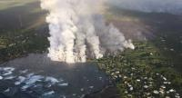 A handout photo made available by USGS shows lava flow originating from Fissure 8 entering Kapoho Bay, Hawaii, USA, on June 4.//EPA-EFE