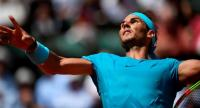Spain's Rafael Nadal returns the ball to Argentina's Diego Schwartzman during their men's singles quarter-final match on day twelve of The Roland Garros 2018 French Open tennis tournament in Paris on June 7, 2018. / AFP PHOTO / Eric FEFERBERG