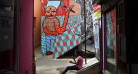 A mural enlivens a poor Mumbai neighbourhood. /AFP