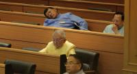 Legislators fall asleep during an assembly that debated the Bt3-trillion national budget.