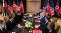 US President Donald Trump (3rd R) and North Korea's leader Kim Jong Un (3rd L) sit down with their respective delegations for the US-North Korea summit, at the Capella Hotel on Sentosa island in Singapore on June 12, 2018./AFP
