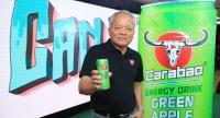Sathien Setthasit, chief executive officer of Carabao Group Plc, shows off new Carabao CAN Green Apple product.