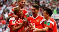 Russia's midfielder Yuri Gazinskiy (L) celebrates scoring the opening goal with his teammates.