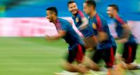 Spain's midfielder Thiago Alcantara (L) takes part in a training session with his teammates at the Fisht Olympic Stadium in Sochi.