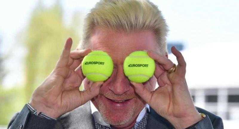 Former German tennis star Boris Becker jokes with tennis balls as he poses during a press conference on April 20, 2018 in Munich.